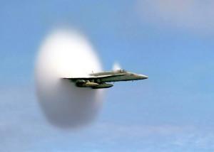 FA-18_Hornet_breaking_sound_barrier_(7_July_1999)_-_filtered