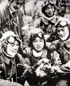 Five kamikaze pilots playing with a puppy, May 26, 1945